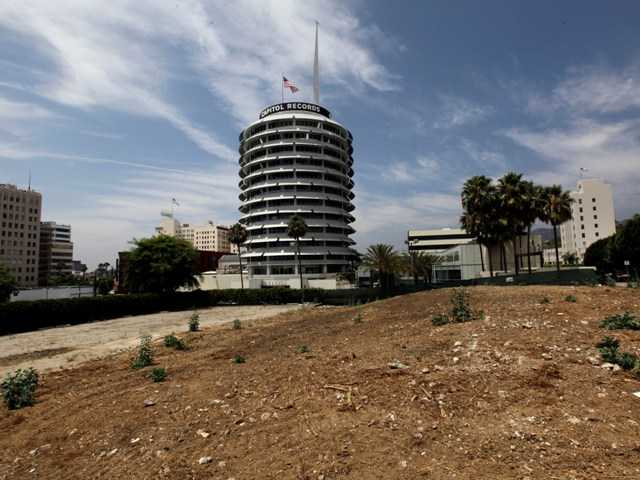 Neighborhood groups have filed a lawsuit to stop a skyscraper from being built in Hollywood by the famed Capital Records buildig because of earthquake concerns.