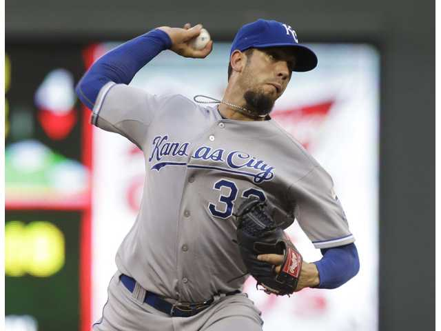 Kansas City Royals and Hart graduate James Shields throws against the Minnesota Twins on Tuesday in Minneapolis.