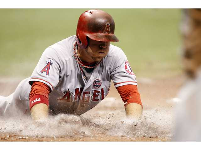 Los Angeles Angels' J.B. Shuck slides safely into home against the Tampa Bay Rays to score a run in the six inning Thursday in St. Petersburg, Fla.