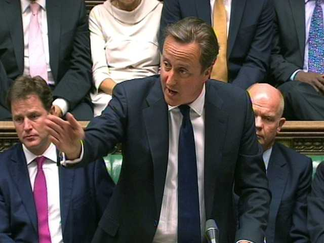 In this image taken from video, Britain's Prime Minister David Cameron, centre, speaks during a debate on Syria, in Britain's parliament, London, on Thursday.