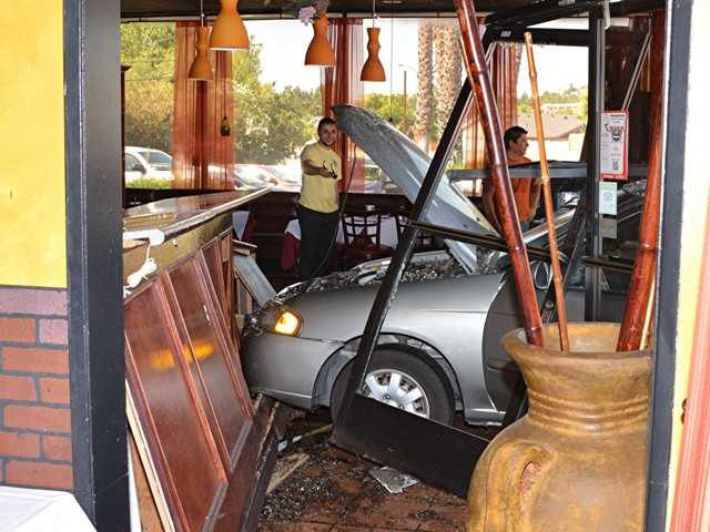 No one was injured today when a Nissan Sentra was driven over the curb and into the Persia Restaurant on Bouquet Canyon Road in Saugus. Rick McClure/For The Signal