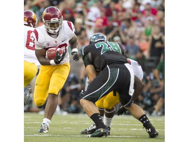 USC running back Tre Madden (23) tries to run past Hawaii linebacker Julian Gener (28) on Thursday in Honolulu.