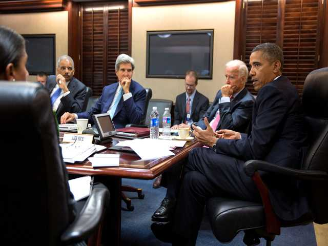 In this image provided by The White House, President Barack Obama meets with his national security staff to discuss the situation in Syria.