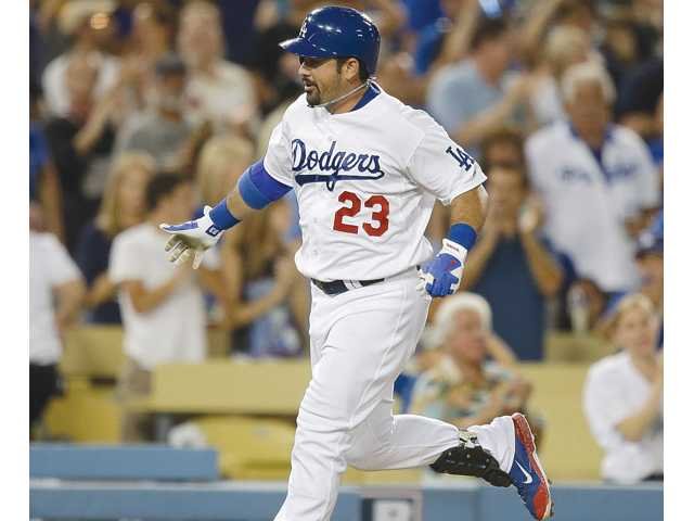 Los Angeles Dodgers Adrian Gonzalez rounds the bases after hitting a home run against the San Diego Padres on Friday in Los Angeles.