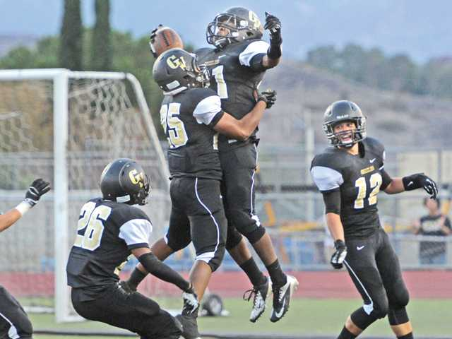 Golden Valley players celebrate after Malik Young (21) returned a blocked punt for a touchdown at Canyon High on Friday.