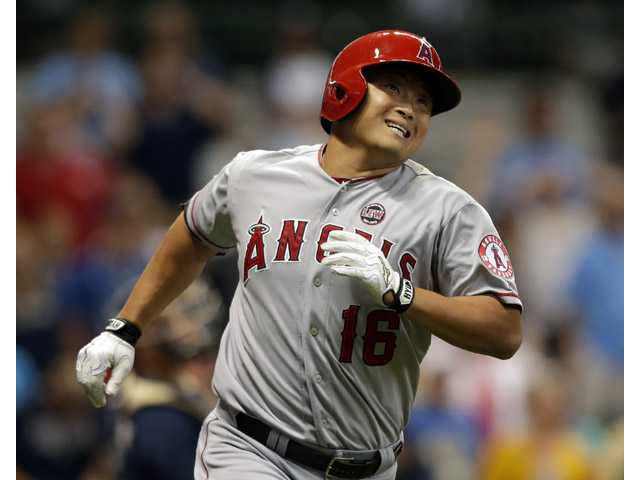 Los Angeles Angels' Hank Conger watches his two RBI home run against the Milwaukee Brewers during the ninth inning on Saturday in Milwaukee.