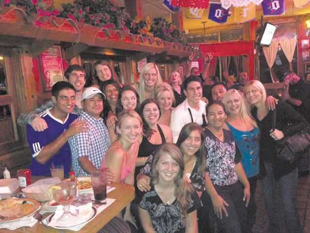 (Right) The Greenhouse Café employees held their goodbye party at La Cocina Bar & Grill on Aug. 26. Many of the staff members had been long-term employees of the family restaurant, which was in business for 18 years at the same location in Saugus.