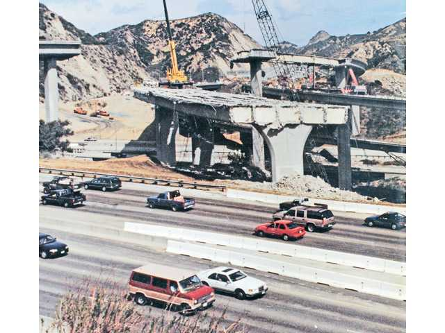 A photo shows the interchange between Interstate 5 and California State Route 14 following the 1994 Northridge earthquake.