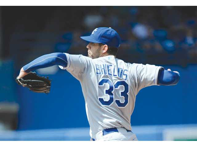 Kansas City Royals pitcher and ex-Hart High player James Shields pitches against the Toronto Blue Jays during the first inning on Sunday in Toronto.