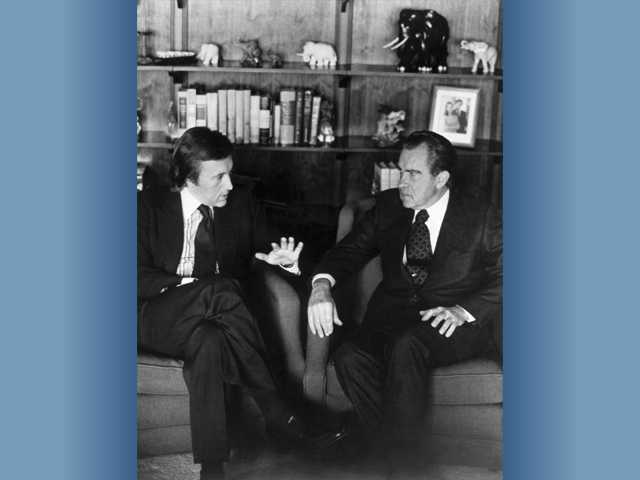 David Frost, left, talks with former President Richard Nixon in this March 1977 file photo prior to the taping of his interview with the former President. Veteran broadcaster David Frost, who won fame around the world for his interview with former President Richard Nixon, has died, his family told the BBC. He was 74.