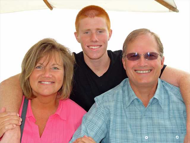 This photo provided by the Laspisa family shows Bryce, center, with his mother Karen and father Michael.