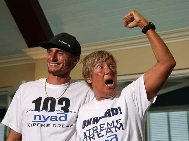 United States endurance swimmer Diana Nyad, right, and one her shark divers, Niko Gazzace, celebrate her record-setting swim from Cuba to Florida.