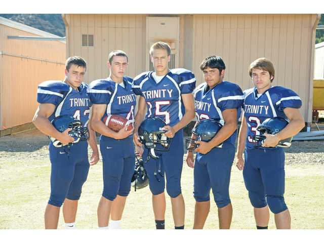 Trinity Classical Academy football players (from left to right) Patch Kulp, Spencer Klehn, Ryan Brooks, Eli Skorich, James Almeida.