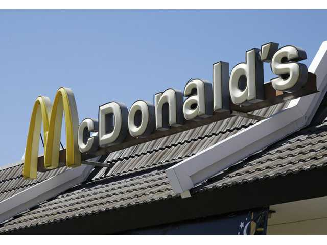 In this April 20, 2012, file photo, a McDonald's sign is shown at a McDonald's restaurant in East Palo Alto.