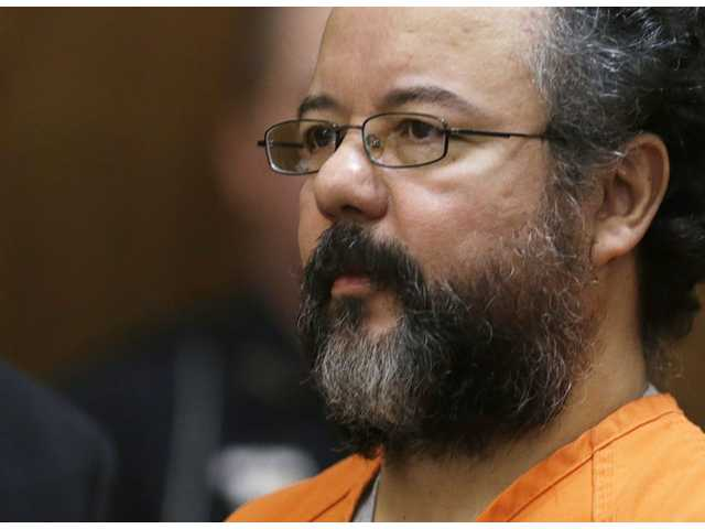 This Aug. 1 file photo shows Ariel Castro in the courtroom during the sentencing phase in Cleveland. Castro, who held 3 women captive for a decade, committed suicide on Tuesday.