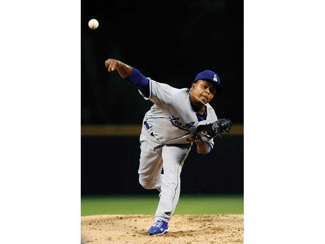 Los Angeles Dodgers starting pitcher Edinson Volquez throws against the Colorado Rockies on Wednesday in Denver.