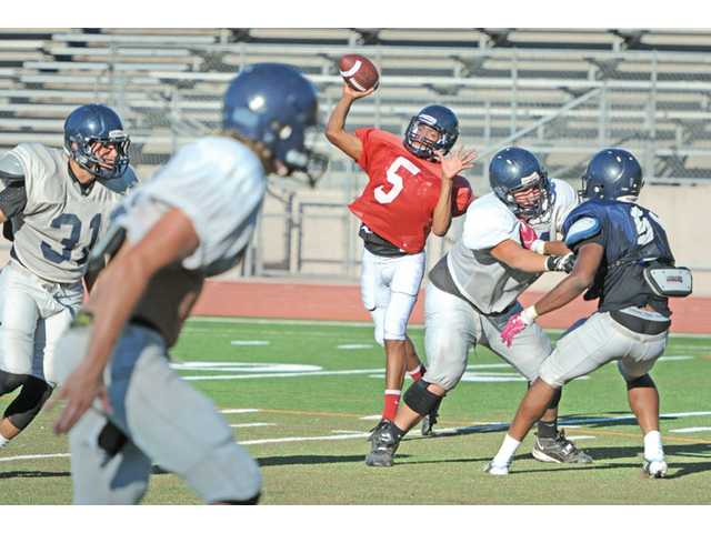 College of the Canyons quarterback Tony Dawson throws during COC practice on Tuesday. Dawson will split snaps this season with Jake Dashnaw.