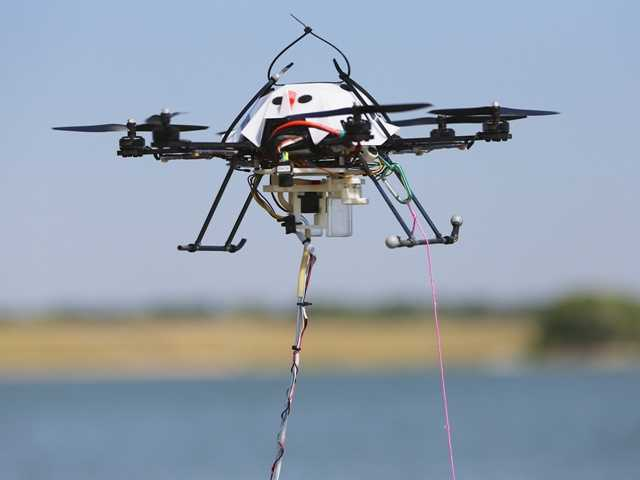 A team led scientists will further develop aerial drones that canhover over and sample water from lakes, ponds and streams that people can't easily reach.