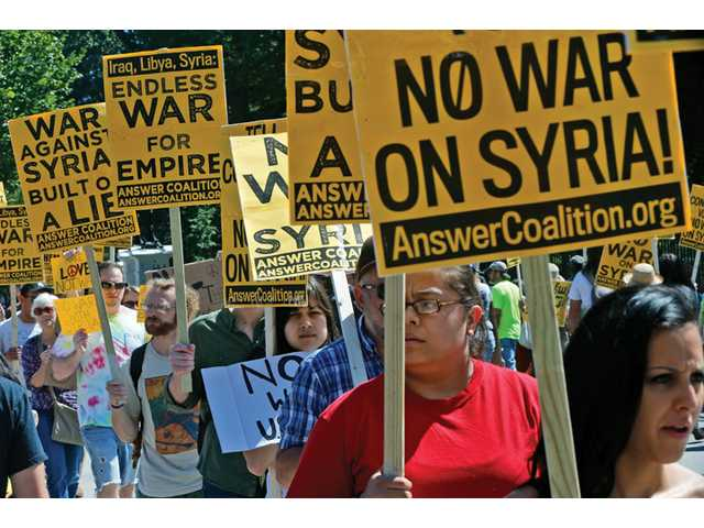 Anti-war demonstrators in Washington protest against possible U.S. military action in Syria in front of the White House on Saturday.