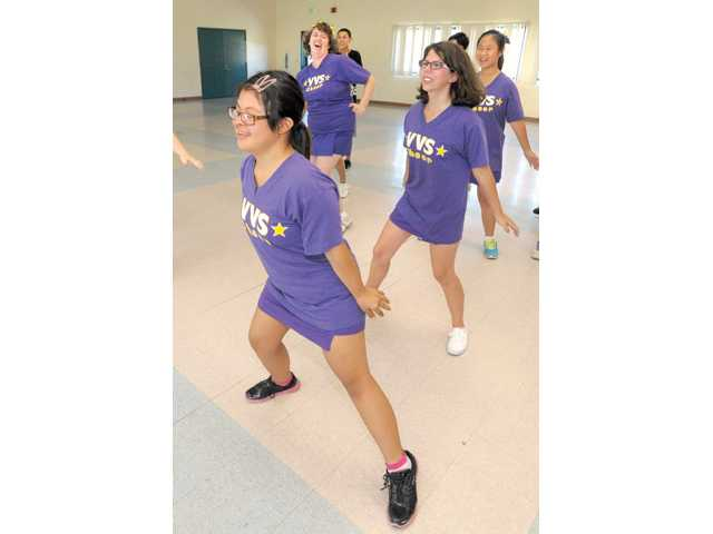 From left, Briana Reyes, Kayla Minniss, Amie Baldwin and Shijai Khoof of the Valencia Vikings Star Cheer team practice on Thursday at Valencia High.