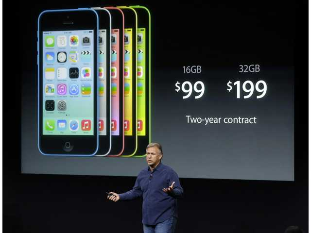 Phil Schiller, Apple's senior vice president of worldwide product marketing, speaks on stage during the introduction of the new iPhone 5c in Cupertino on Tuesday.
