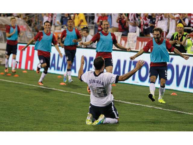 United States' Landon Donovan, front, celebrates his goal against Mexico during the second half of a World Cup qualifying soccer match Tuesday in Columbus, Ohio. The United States won 2-0.