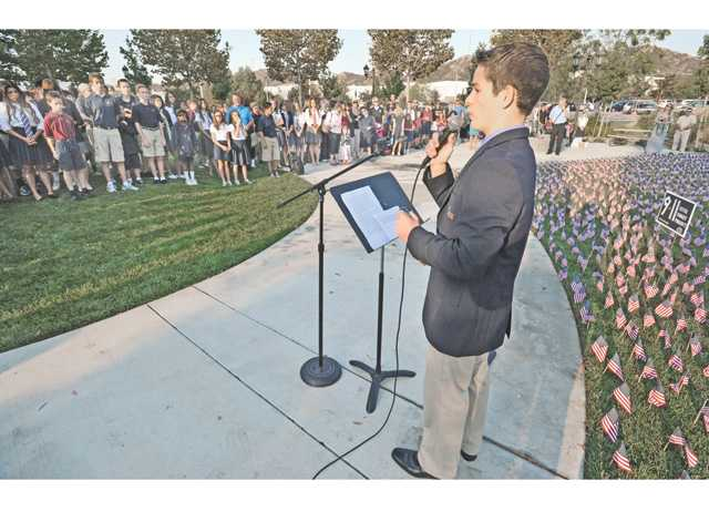 Event organizer and school senior Grant Wolf addresses dozens of attendees at the 9/11 memorial for victims of the Sept. 11, 1001, terrorist attacks. Signal photo by Dan Watson