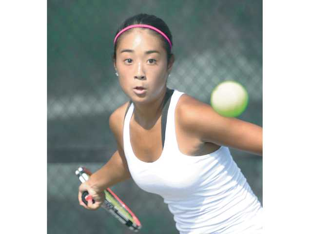 Valencia's Katelyn Choi prepares to hi the ball against Calabasas High on Wednesday at Valencia High School.