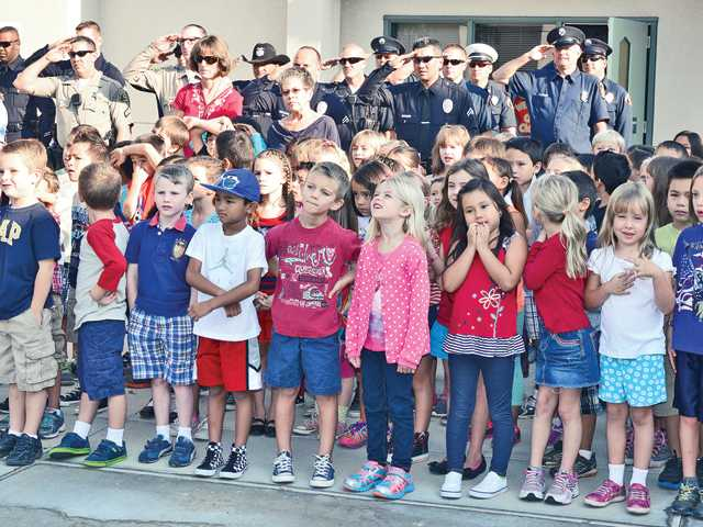 Local heroes and students celebrate Patriot Day at North Park Elementary. Several local schools held outdoor assemblies to commemorate 9/11.