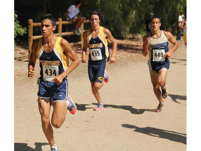 College of the Canyons freshmen Rodrigo Ornelas, left, and Robert Pion, center run at the Southern California preview meet on Friday at Central Park. Jesse Munoz/College of the Canyons Sports Information