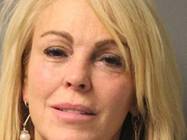 Booking photo provided by the N.Y. State Police shows Dina Lohan, 50, after she was arrested late Thursday on aggravated drunken driving charges.