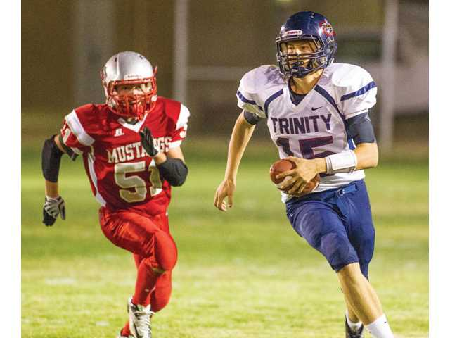 Trinity Classical Academy's Ryan Brooks, right, is pursued by Mojave's Garrett Scott on Friday at Mojave High.