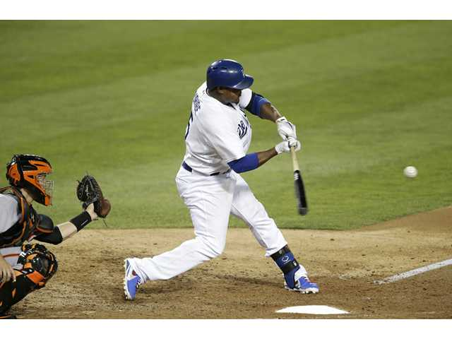 Los Angeles Dodger Juan Uribe hits a two-run home run against the San Francisco Giants on Friday in Los Angeles.