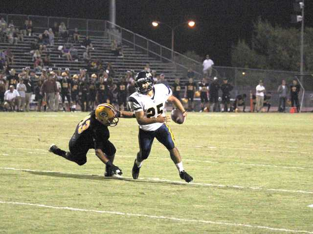 West Ranch graduate and College of the Canyons player Gabe Peralta turns the corner against Saddleback College on Saturday night at Saddleback College on a 3-yard touchdown run.