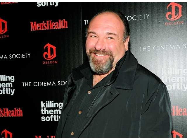 "In this Nov. 26, 2012, file photo, actor James Gandolfini attends a special screening of ""Killing Them Softly"" hosted by The Cinema Society, Men's Health and DeLeon at the SVA Theater in New York. Emmy organizers say the awards ceremony will include five special memorial tributes, including Cory Monteith and James Gandolfini."