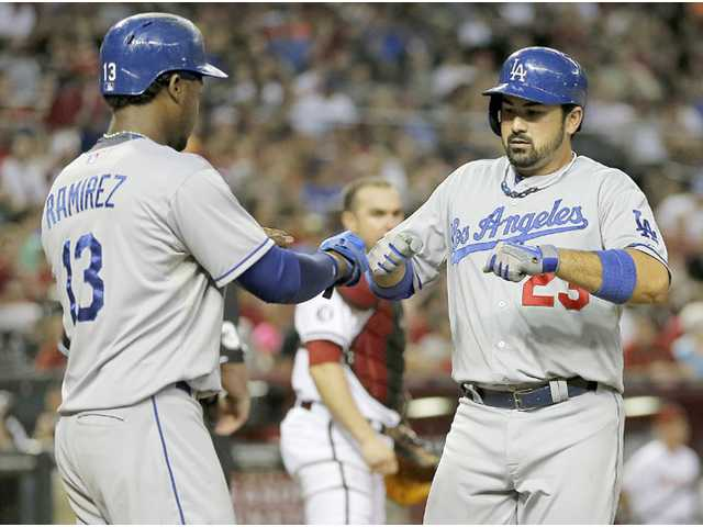 Los Angeles Dodger Adrian Gonzalez (23) is congratulated by Hanley Ramirez (13) on Tuesday in Phoenix.