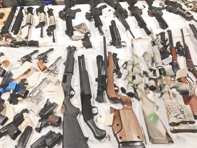 This photo shows some of the guns recovered from the Simi Valley home of a man suspected of being behind a theft from a firearms manufacturer in Castaic earlier this month. Officials estimate they recovered anywhere from 40 to 50 guns. Photo courtesy of the Santa Clarita Valley Sheriff's Station.