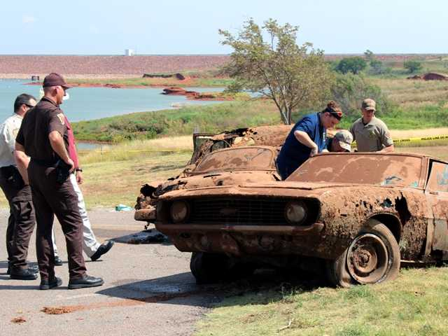 Decades-old cars were pulled from the water in Oklahomaand the remains may be of three teenagers who disappeared on their way to a high school football game in 1970.