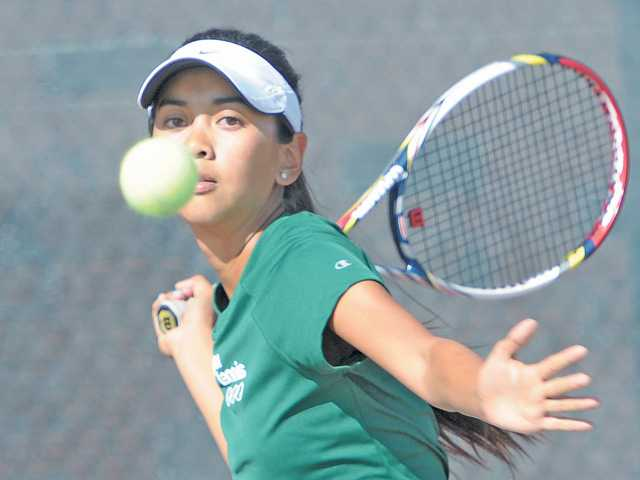 Canyon High tennis player Katrina DeGuzman squares up to hit the ball during a match against Crescenta Valley at Canyon on Wednesday. DeGuzman won all three of her sets, but Canyon lost 13-5.