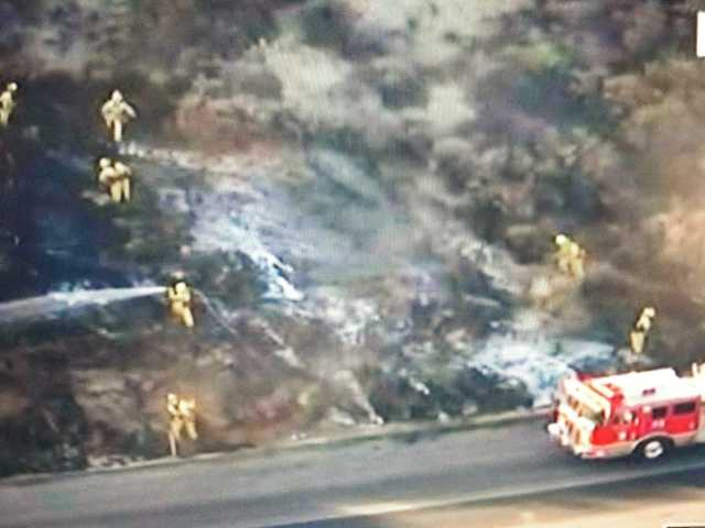 A brush fire off Golden Valley Road Thursday morning. KTLA news screen shot