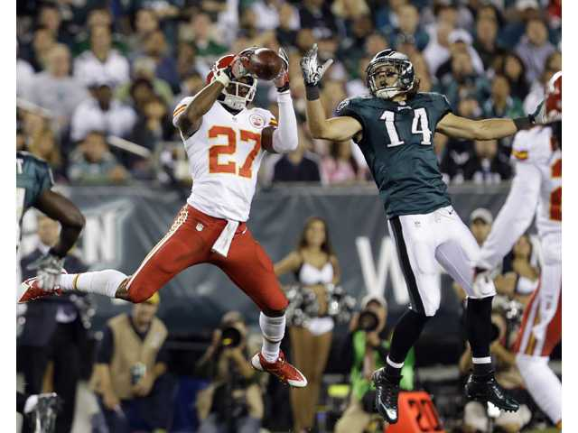 Kansas City Chiefs' Sean Smith (27) intercepts a pass intended for Philadelphia Eagles' Riley Cooper (14) on Thursday in Philadelphia.
