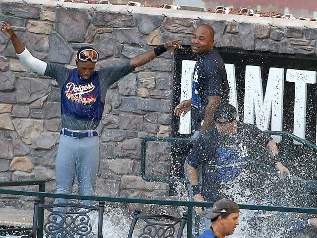 L.A. Dodgers players celebrate in the Chase Field pool after the Dodgers clinched the NL West title with a 7-6 win over the Arizona Diamondbacks in a baseball game Thursday.