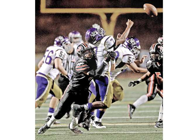Hart's Cody Shoemaker sacks Ridgeview quarterback Lawrence White in the second quarter of the game. Photo by Jayne Kamin-Oncea.