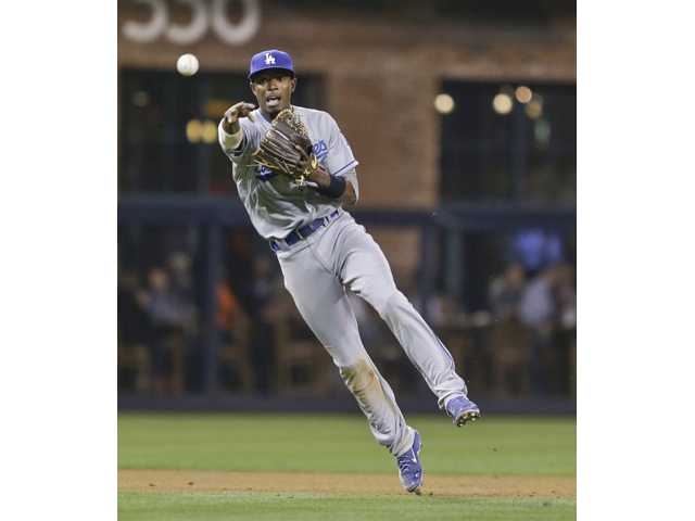 Los Angeles Dodgers shortstop Dee Gordon makes an off-balance throw to get the out on San Diego Padres' Tommy Medica on Friday in San Diego.