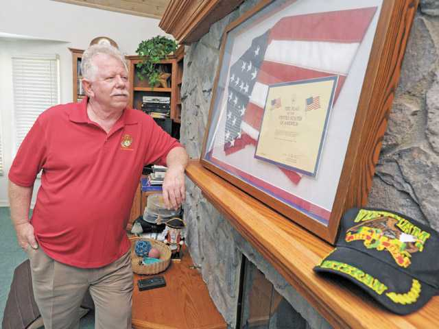 Vietnam War veteran R.J. Kelly was awarded two Purple Hearts and a commendation medal.