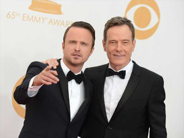 Aaron Paul, left, and Bryan Cranston arrive at the 65th Primetime Emmy Awards at Nokia Theatre on Sunday in Los Angeles.