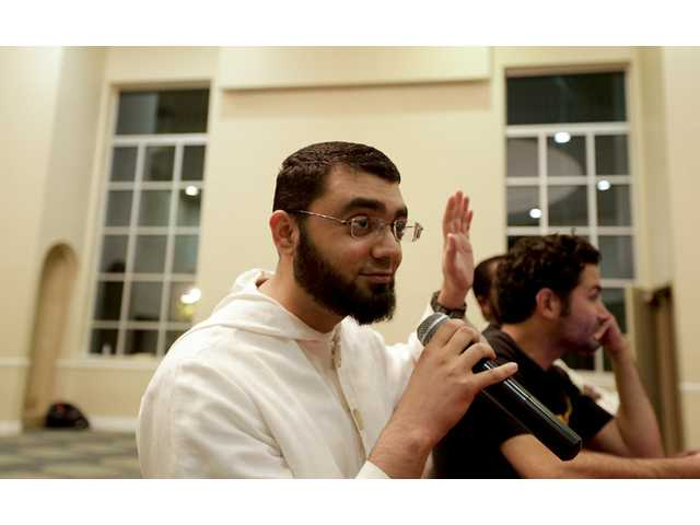 Mustafa Umar, an imam, takes questions during a youth group meeting at a mosque on Sept. 6 in Anaheim.