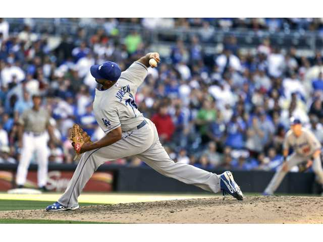 Los Angeles Dodgers closer pitcher Kenley Jansen fires a pitch against the San Diego Padres on Sunday in San Diego.