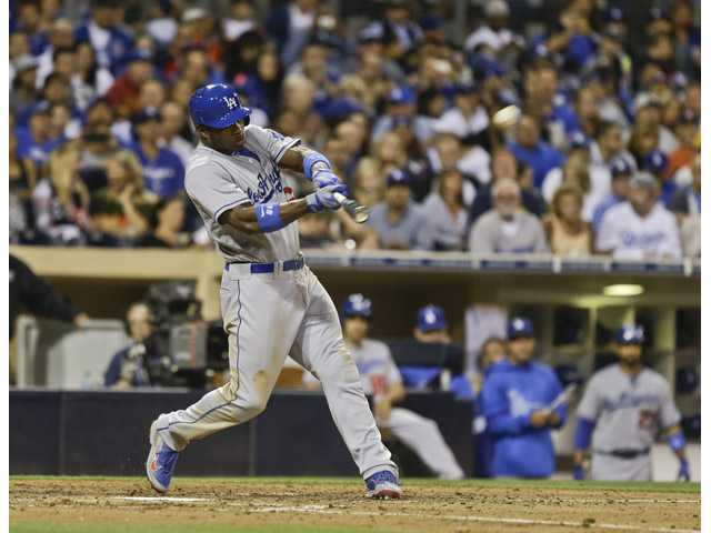 Los Angeles Dodger Yasiel Puig hits a two-run homer to center field against the San Diego Padres on Saturday in San Diego.
