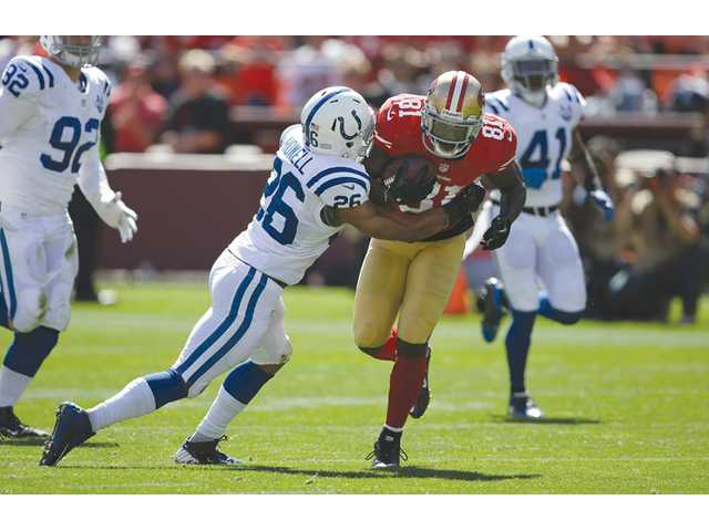 Indianapolis Colts defensive back and Hart graduate Delano Howell (26) tackles San Francisco 49ers wide receiver Anquan Boldin (81) in San Francisco on Sunday.